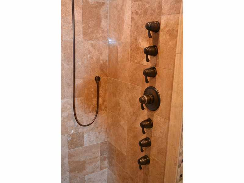 Water Feature Wall in a Travertine Shower - JW Construction & Design Studio Services