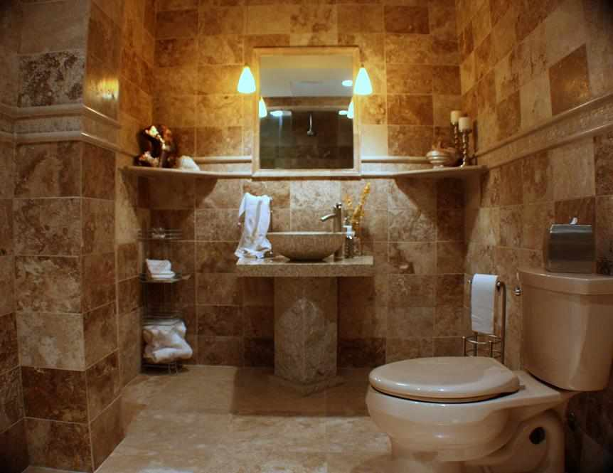travertine bathroom with pedestal sink jw construction design chicago area bathroom remodel